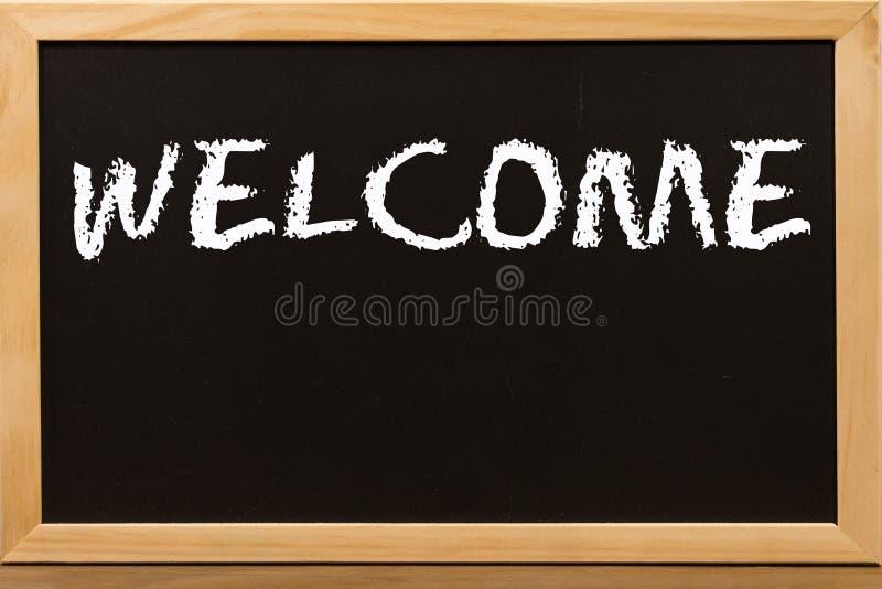 欢迎由白色白垩写在黑板 图库摄影