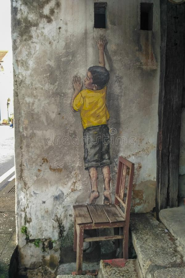 欧内斯特'2013年7月6日绘的街道壁画题为'到达Zacharevic在槟榔岛 免版税库存图片