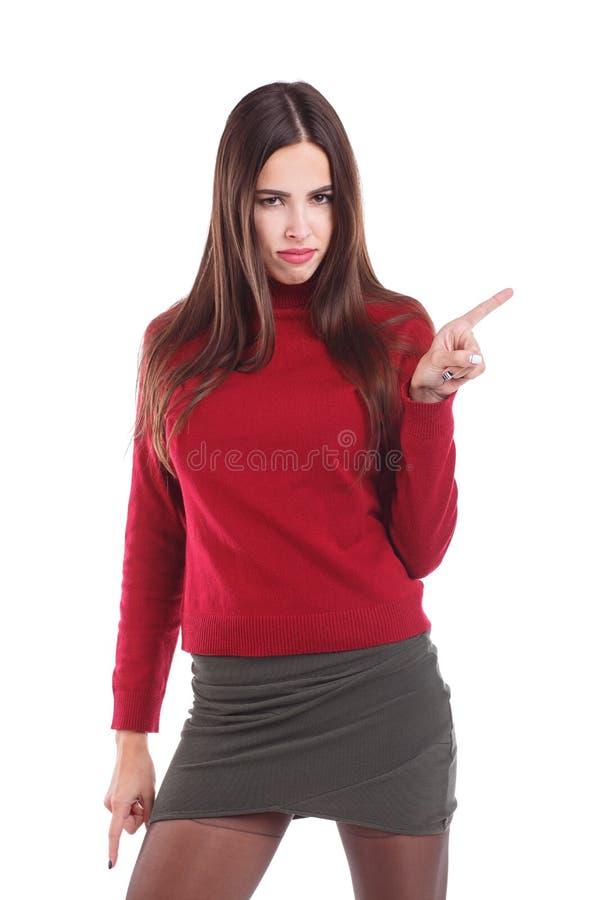 欧洲女孩,与严肃的神色和挥动她的食指的立场 查出在白色 库存照片