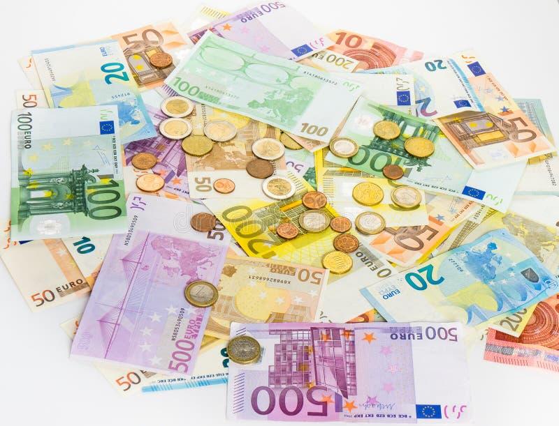 欧洲钞票和硬币金钱提供经费给在白色bac的概念现金 库存照片