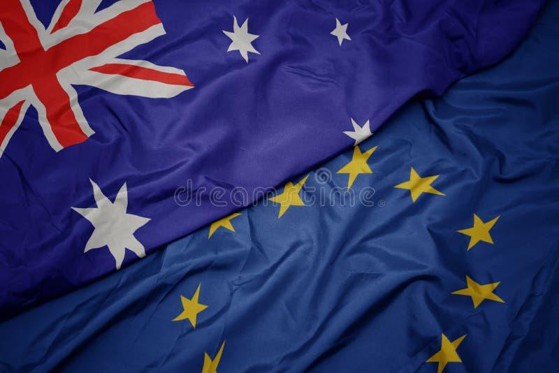欧盟挥动的五颜六色的澳大利亚的旗子和旗子 免版税库存图片