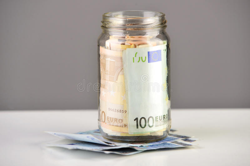 欧洲钞票卷在金钱瓶子的 免版税库存图片