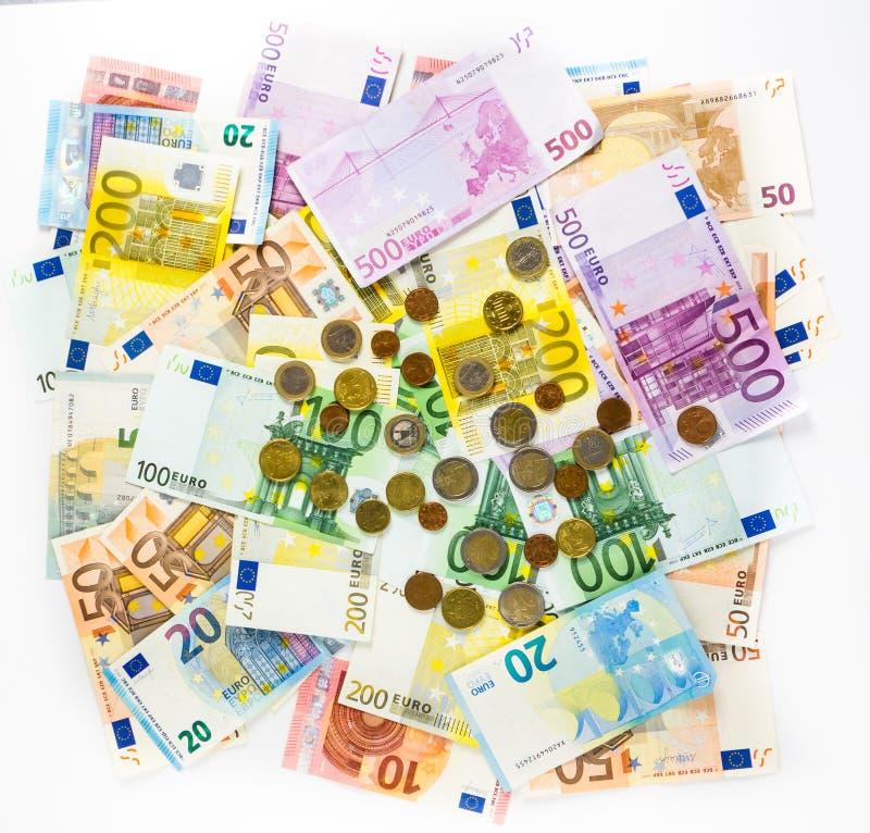 欧洲钞票和硬币金钱提供经费给在白色bac的概念现金 免版税库存图片