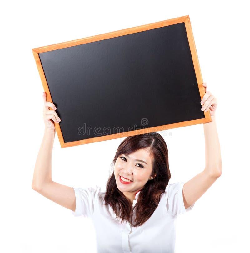 阻止黑板的可爱的少妇 库存图片
