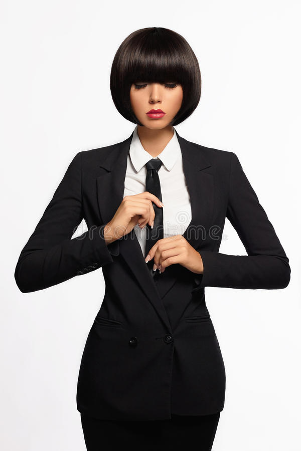 正式衣服和领带的女商人 免版税库存图片