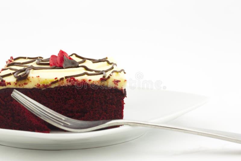 正方形红色天鹅绒蛋糕裁减片断与叉子的 图库摄影