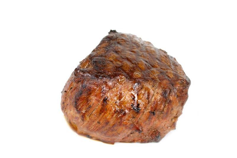 正餐内圆角烤isolat水多的可爱的牛排 免版税库存图片