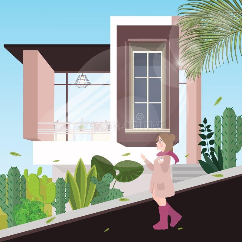 步行沿着向下那里街道单独背景的女孩是有植物的现代房子在冷气候 皇族释放例证