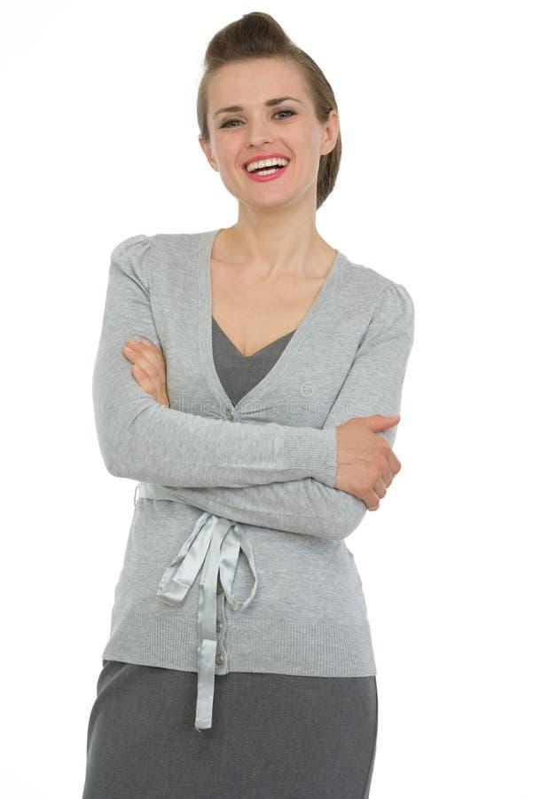 武装商业克服的愉快的纵向妇女 免版税库存图片