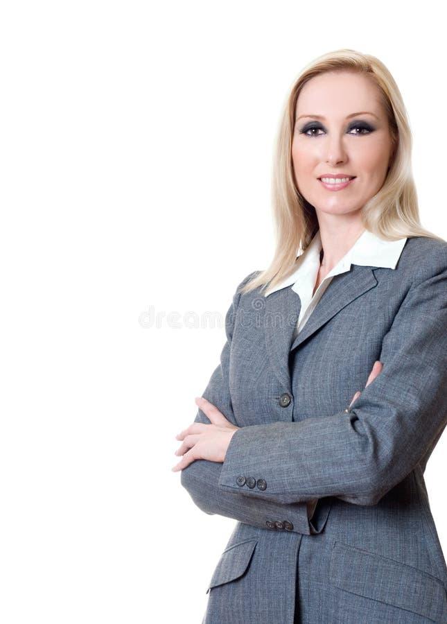 武装女实业家克服的微笑 免版税库存照片