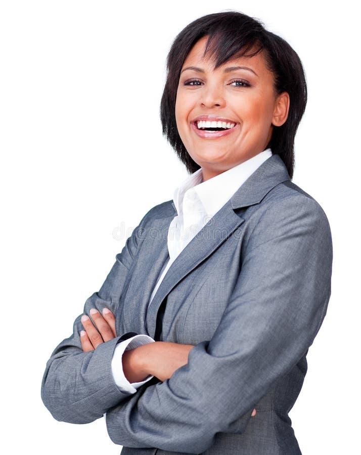 武装女实业家被折叠的笑 免版税图库摄影