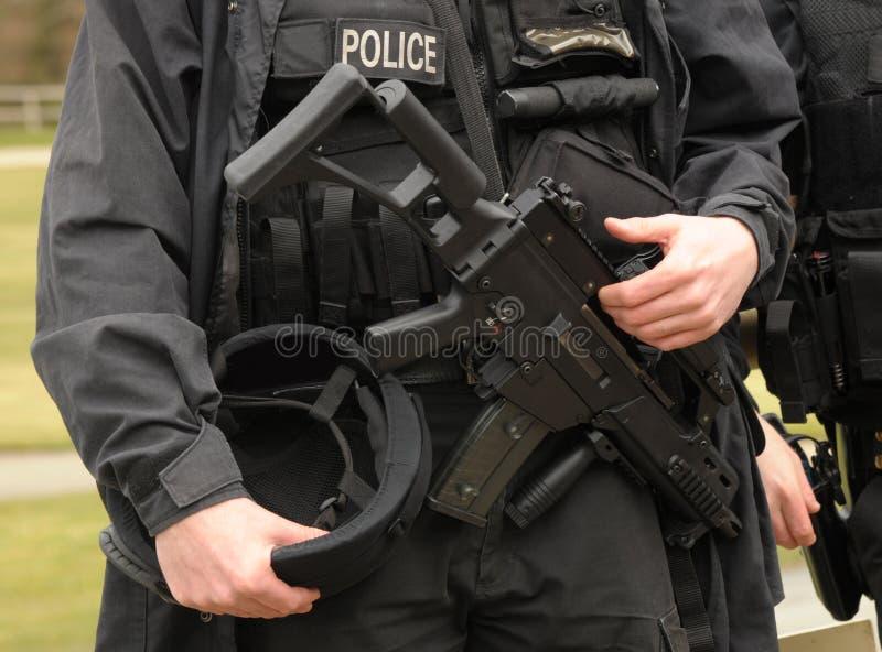 武装的警察扑打 免版税库存照片