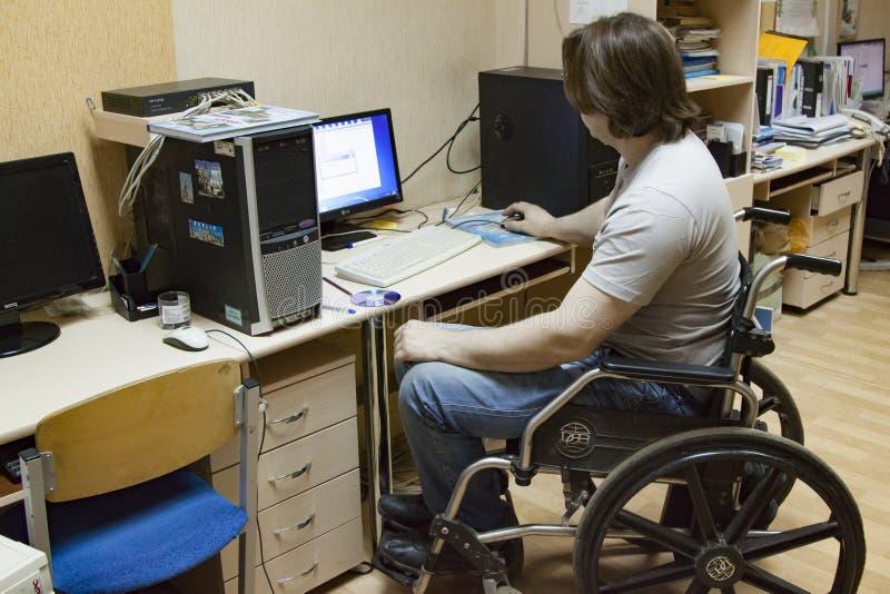 残疾人在工作 免版税库存照片
