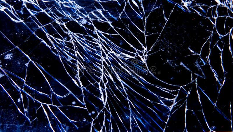 残破的易碎的玻璃电话 图库摄影