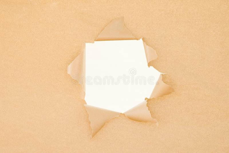 残破的棕色漏洞纸张 库存照片
