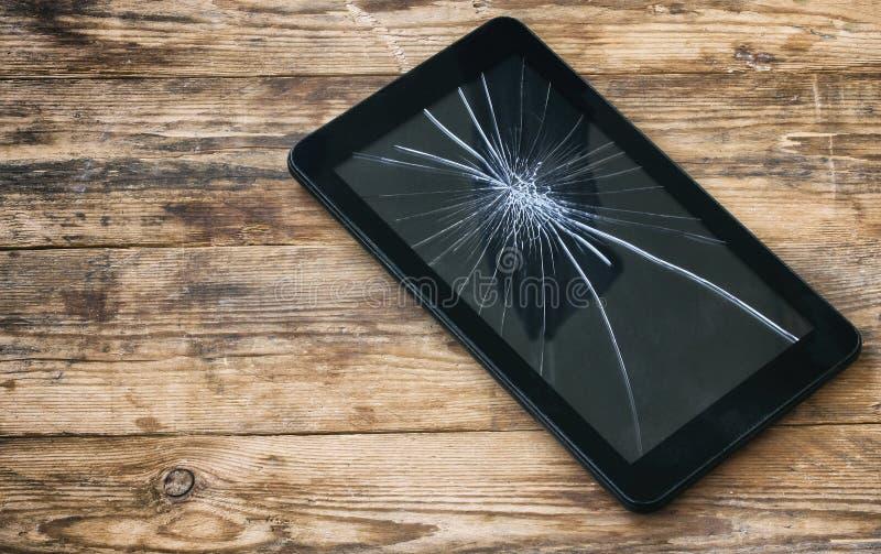 残破的片剂计算机,破裂的玻璃显示 库存照片