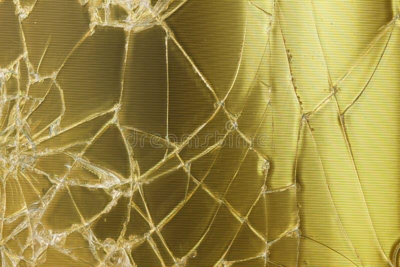 残破的玻璃金背景 免版税库存图片