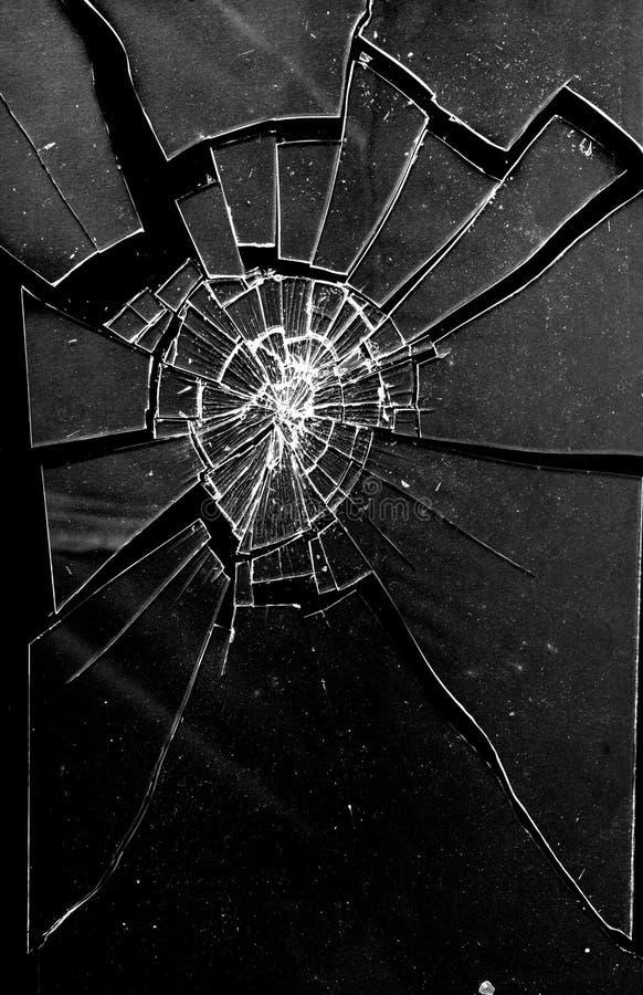 残破的被打碎的玻璃墙纸背景 图库摄影