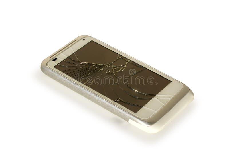 残破的白色银色智能手机  免版税库存图片