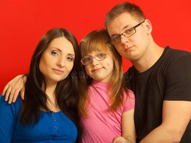 父亲插女儿_母亲,女儿和父亲家庭照片 库存图片