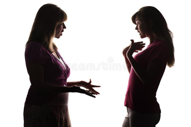 母亲与女儿,少年尖叫争论,证明无罪 图库摄影