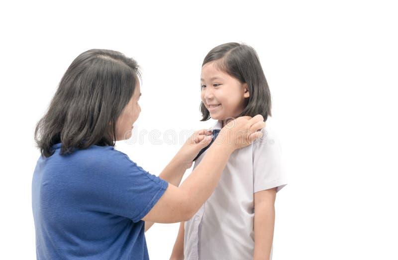 母亲军礼服学生她的女儿 免版税库存照片