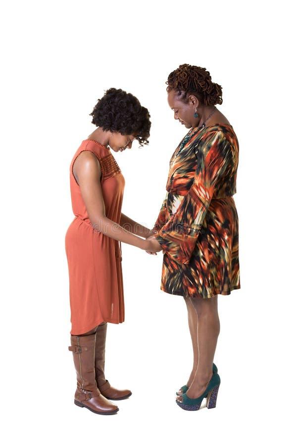 母亲和女儿祈祷 库存图片