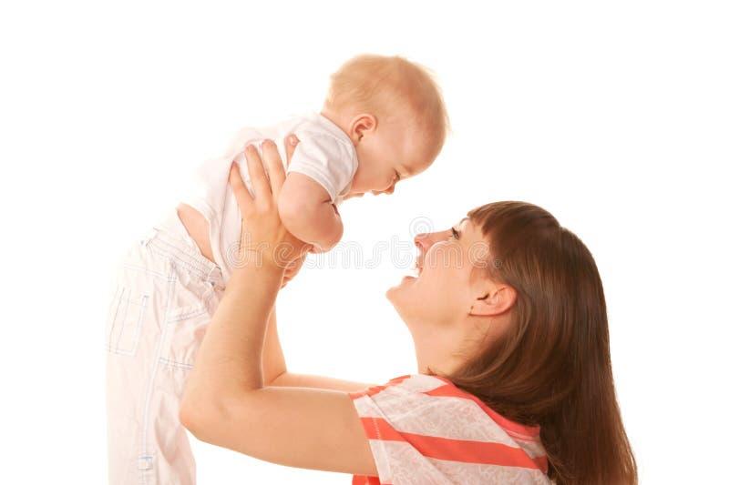 母亲和婴孩笑 图库摄影