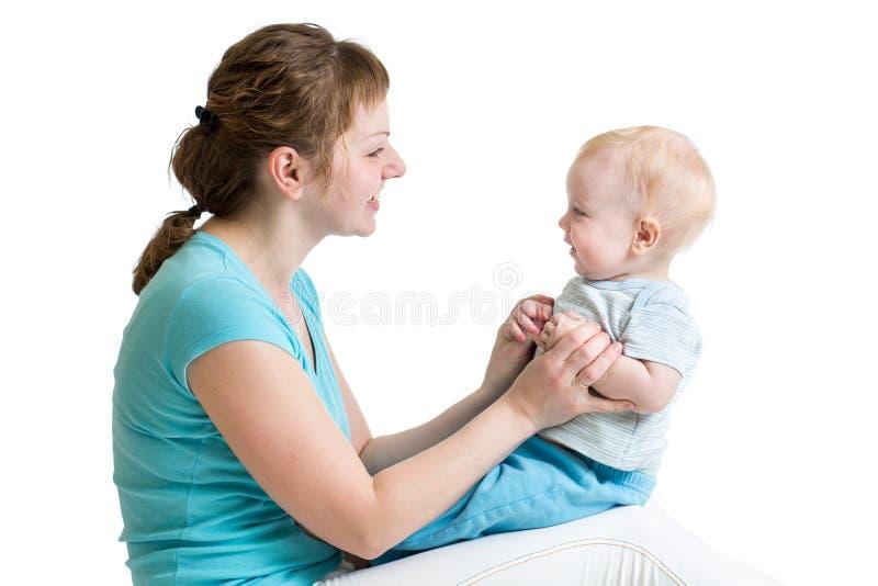 母亲和婴孩使用。母性 图库摄影