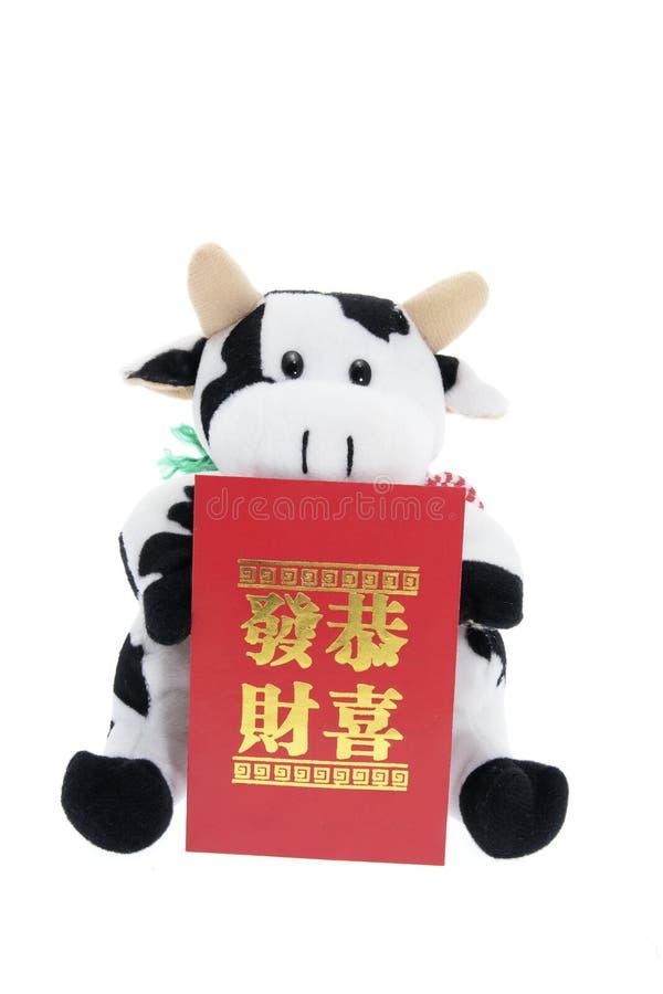 母牛信包幸运的货币软的玩具 免版税图库摄影