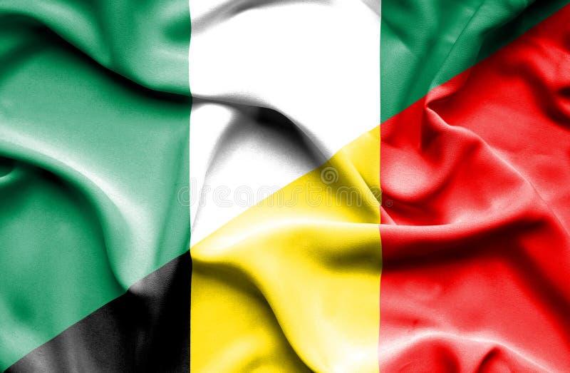 比利时和尼日利亚的挥动的旗子 库存例证