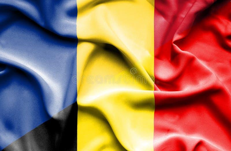 比利时和罗马尼亚的挥动的旗子 库存例证