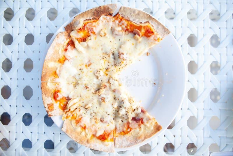 比萨吃了两个切片 免版税图库摄影