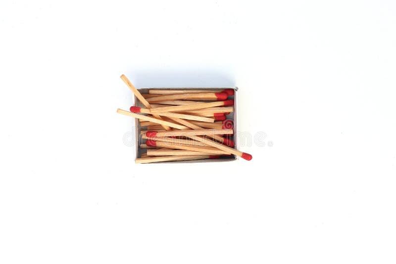 比赛,被打开的火柴盒,在白色背景隔绝的火柴梗 免版税库存照片