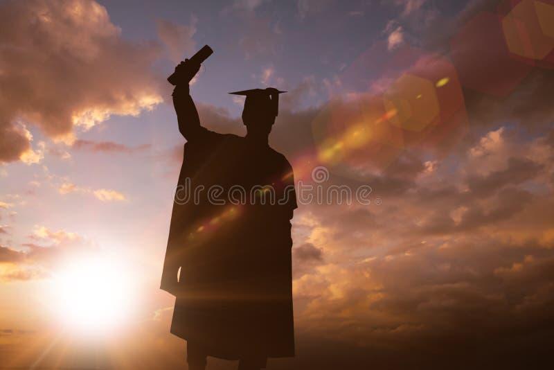 毕业生剪影的综合图象  库存照片