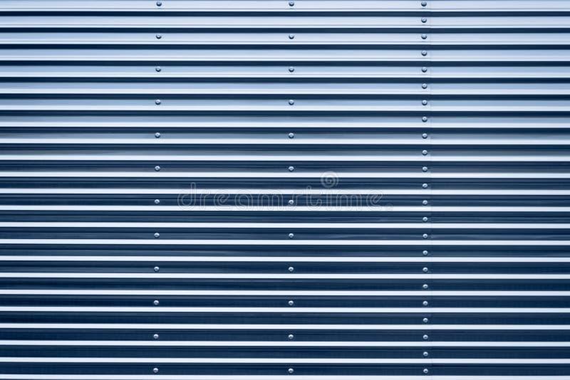 毕业的蓝色被设色的铁表面 库存照片