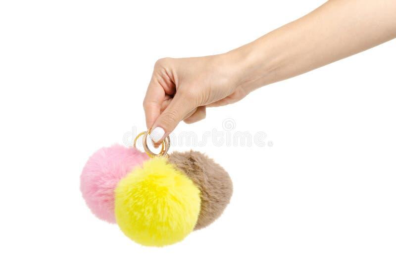 毛皮球小装饰品黄色桃红色褐色在手中 免版税库存图片