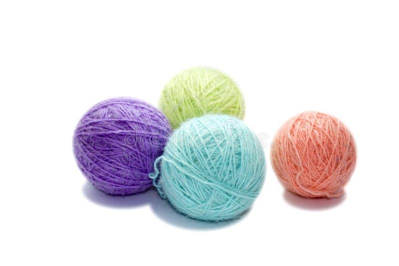 毛线四个杂色球在白色背景的 库存图片
