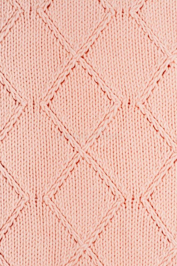 毛线衣或围巾织品纹理大编织 与安心样式的被编织的球衣背景 羊毛手机器,手工制造 免版税图库摄影