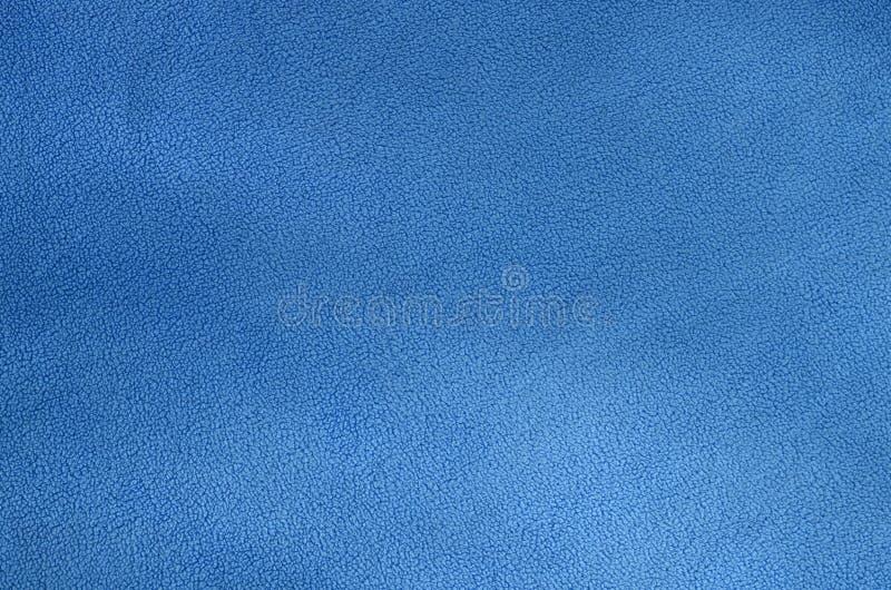 毛茸的蓝色羊毛织品毯子  浅兰的软的长毛绒羊毛材料背景纹理  库存照片