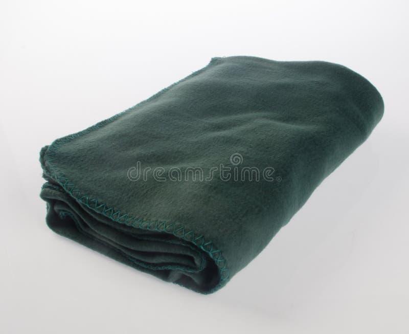 毯子或软的温暖的毯子在背景 免版税库存照片