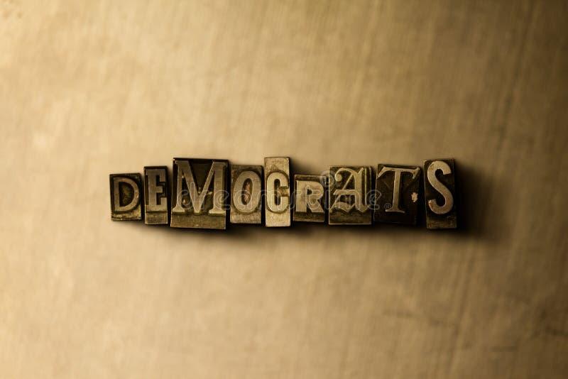 民主党-脏的葡萄酒在金属背景的被排版的词特写镜头  免版税图库摄影