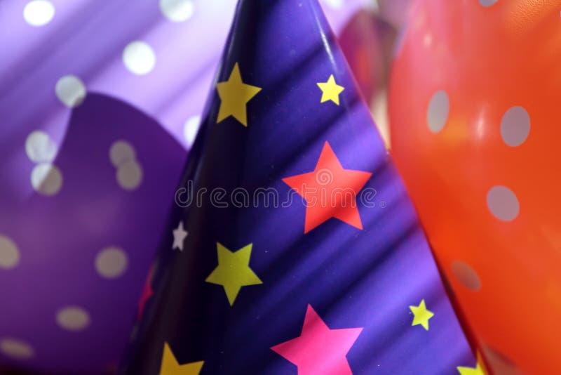 气球和纸帽子首先的可以 免版税库存照片
