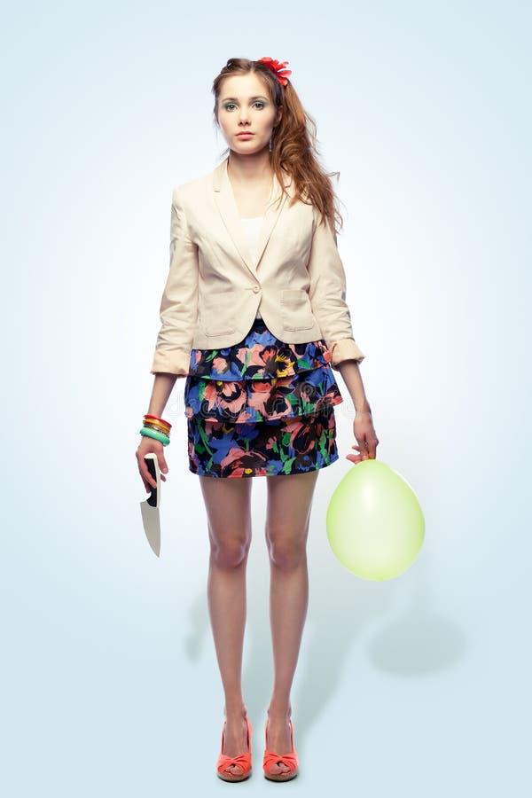 气球女孩刀子 库存图片
