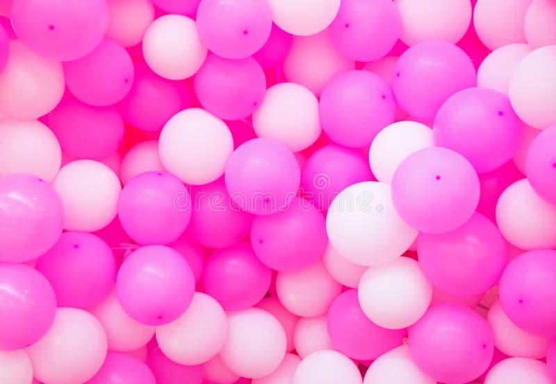 气球背景 桃红色airballoons纹理 女孩生日或浪漫婚礼照片背景 免版税库存图片