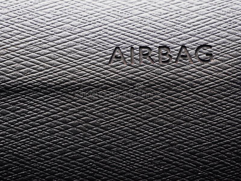 气袋的标志在灰色盘区汽车的 免版税库存照片