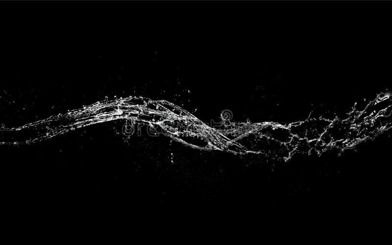 水在黑背景隔绝的飞溅形状 免版税库存图片