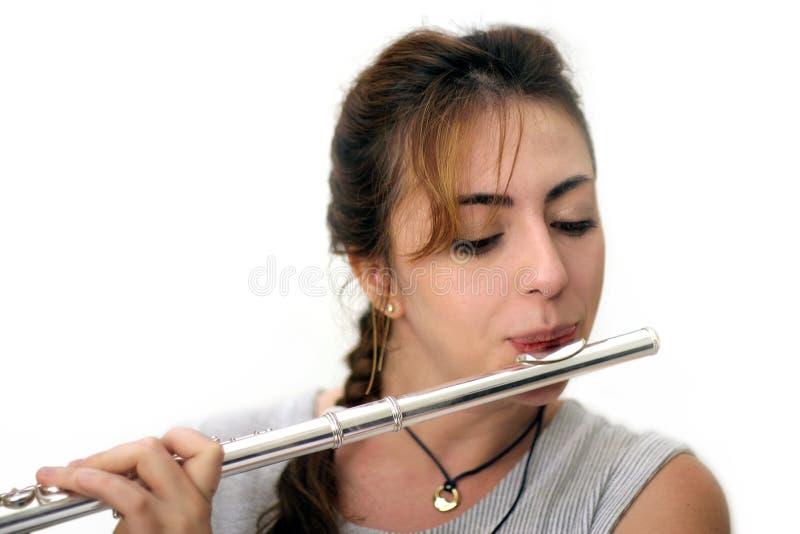 水平美丽的长笛演奏家 库存图片