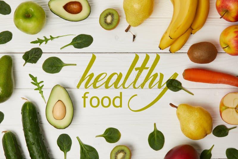 水果和蔬菜顶视图在木背景与拷贝空间,健康食物题字 免版税图库摄影