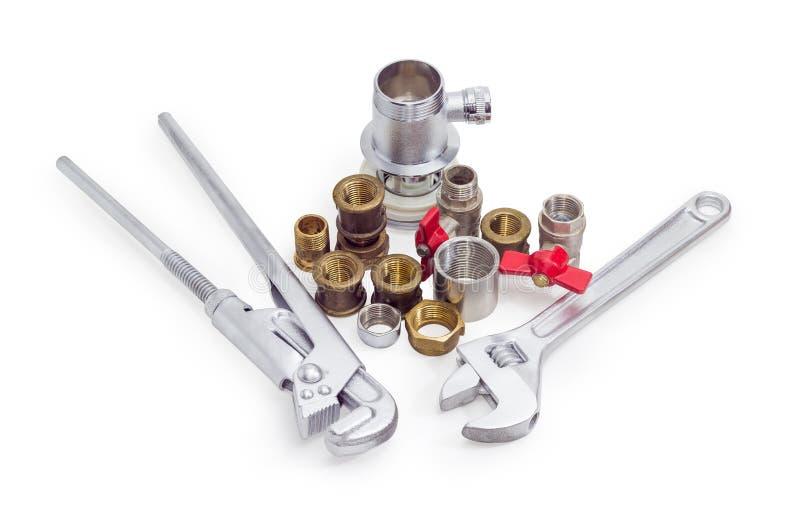 水管工板钳、可调扳手和各种各样的配管组分 图库摄影